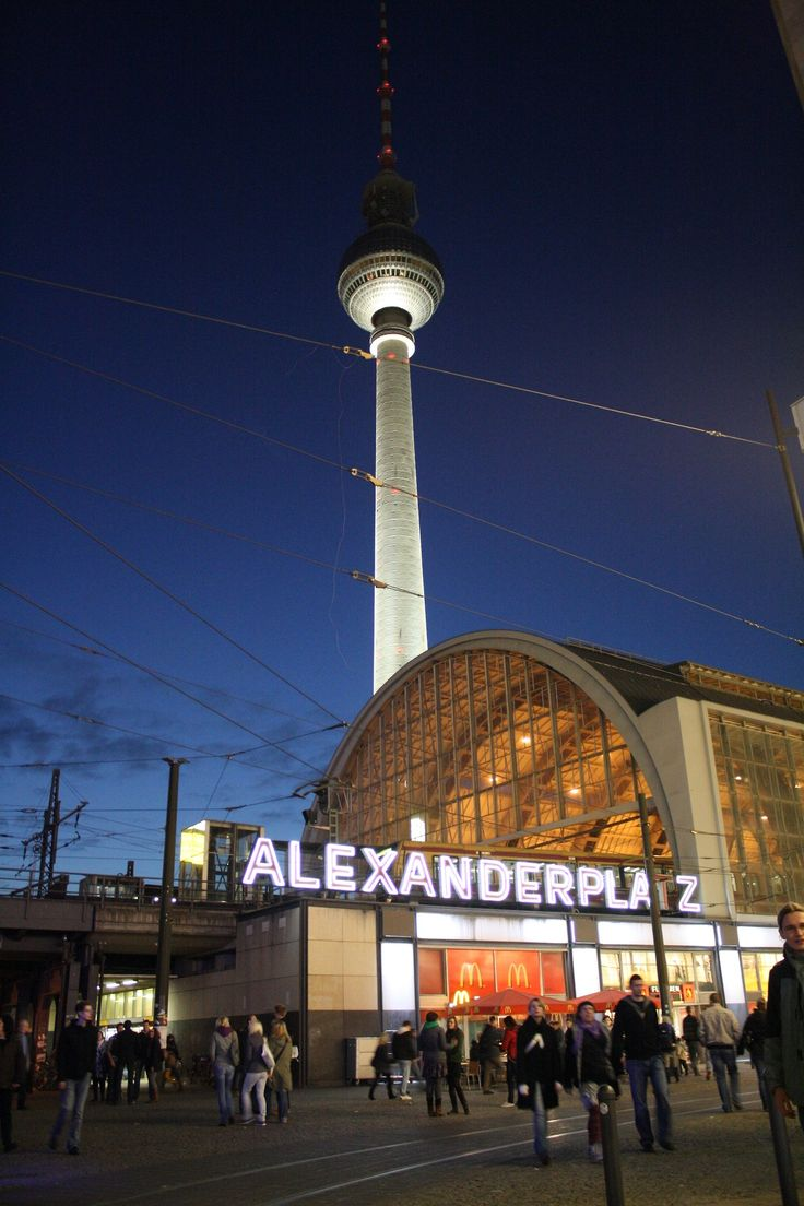 "Der Alexanderplatz is a large public square and transport hub in the ""Mitte"" district of Berlin, near the Fernsehturm. Locals often call it simply Alex, referring to a larger neighborhood around it. Originally a cattle market outside the city fortifications, it was named in honor of a visit of the Russian Emperor Alexander I to Berlin in 1805 by order of King Frederick William III of Prussia. The square gained a prominent role in the late 19th century with the construction of the Stadtbahn…"