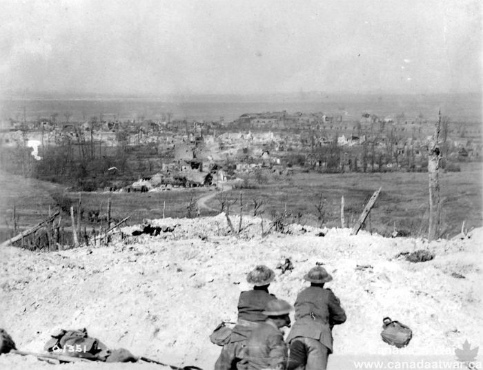 Beyond Vimy, the Douai Plain - This photograph, taken after the capture of Vimy Ridge, looks east over the Douai Plain. The vantage point occupied by the soldiers in the foreground demonstrates the strategic importance of Vimy Ridge.