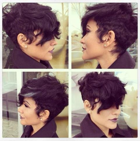 Classy redention of a mohawk. Tapered sides with longer hair uptop and long bangs. A really curly hairstyle with an accent of gray hair in the bang area.    http://www.howtoblackhair.com