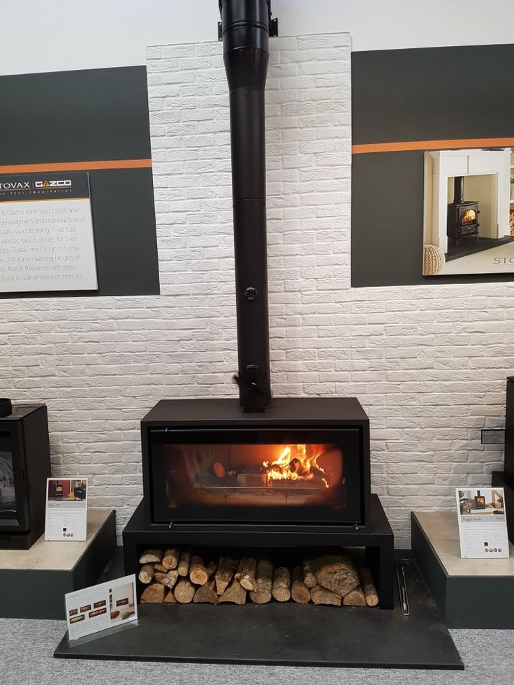 Stovax studio 2 free standing wood burning stove with log store at Taylor Made Projects Barnstaple