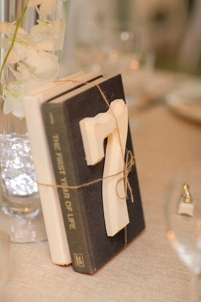 I might do something like this but for each table a different item that describes the bride and groom