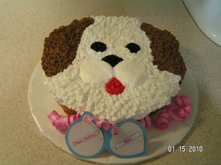 Puppy Dog Cake - I just finished this cake for a 9 year old girl at church who loves dogs. They are cupcakes with all buttercream frosting.