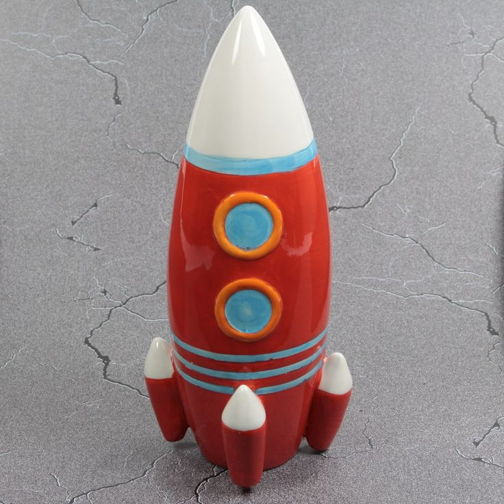 A ceramic piggy bank in a vintage toy spaceship design this rocket ship change bank features a - Rocket ship piggy bank ...