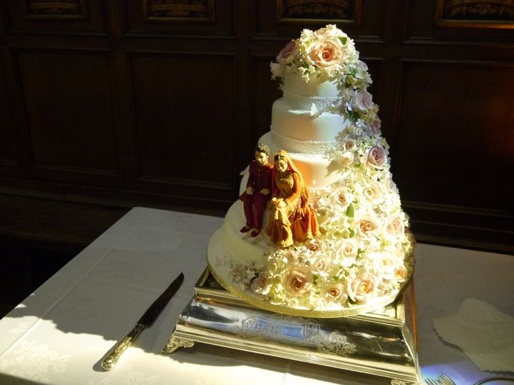 Creative wedding cake with an Indian bride and groom