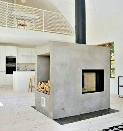 Great double sided fireplace design incorporating wood storage. Skattejakt