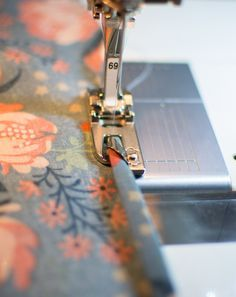 Sewing 201' post! I've been sewing rolled hem foot quite a bit lately, so I snapped a few photos. In this blog post I'm going to share some tips and tricks to get this foot working for you. The rolled hem foot sews just that, a narrow rolled hem that's pretty on scarves, blouses, dresses, or even curtains.