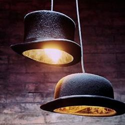 The hat pendant lamps are made with classic British cultural icons, an authentic bowler hat (Jeeves lamp) and an authentic top hat (Wooster).