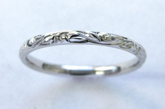 This store has lots of variations on the vine and leaf band.. Hand Engraved Vine and Leaf Wedding Anniversary by NathanJewelers, $420.00
