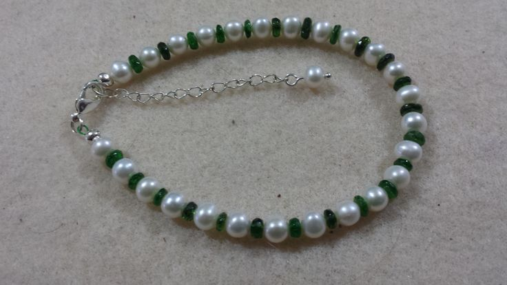 Hand crafted Bracelet with Fresh water cultured White Pearls and Chrome Diopside Rondelles. Silver plated lobster claw clasp and extender chain