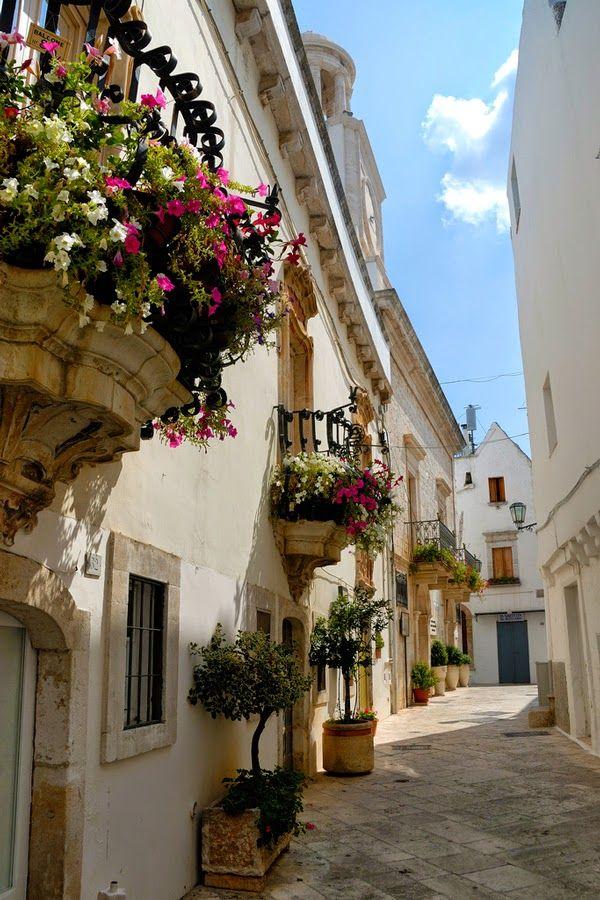 Flower Balconies Against White Walls in Locorotondo, Bari Italy
