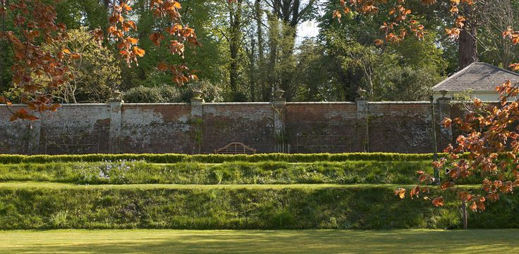 Terraces and espalier plantings along the brick wall