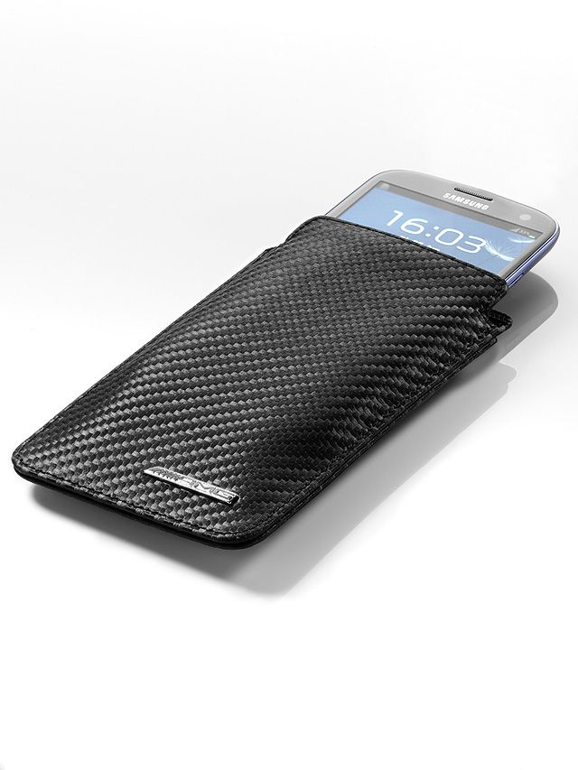 Sleeve for iPhone AMG B66952523  Carbon fibre is a material that oozes exclusivity, sportiness and high quality:  the black cowhide leather is coated with a carbon-fibre-look finish.  A special surface treatment means that the material is also water- and dirt-repellent.  The front features a metal AMG badge. The sleeve is suitable for the iPhone 5. www.pmbeshop.com