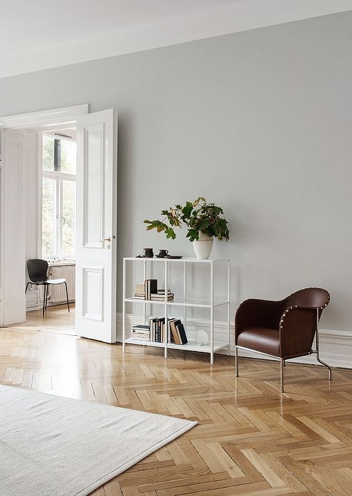 love the light grey wall with wooden floors and white furniture - Grey Interior Paint Schemes