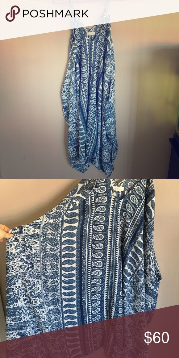 Blue and white jumper This flowy jumper looks and fits like a maxi but has pant holes in the bottom, super cute and comfy! Blue and white paisley print. Wear with statement necklace or cinching belt to dress it up. elan Pants Jumpsuits & Rompers