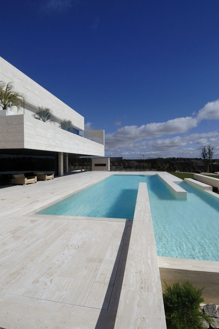 Madrid-based studio A-cero has completed the Vivienda 19 project in 2009. This contemporary concrete residence is located in in a luxurious estate of Pozuelo de Alarcón, a suburb near the city of Madrid, Spain.