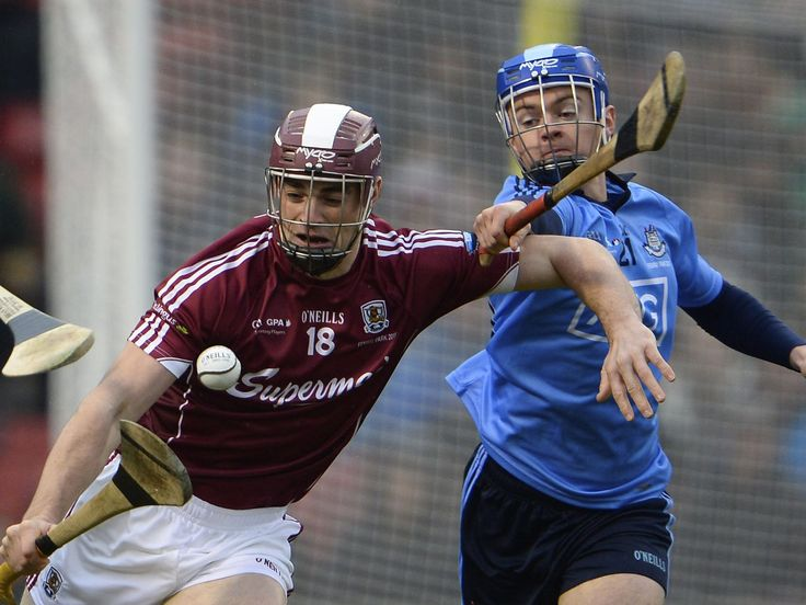 Galway's Greg Lally, left, is challenged by Dubin's Oisin O'Rorke during the AIG Fenway Hurling Classic between Galway and Dublin at Fenway Park in Boston. Hurling, an Irish iconic sport dates back over 2000 years, is played with sticks called a hurley with a ball called a sliotar. CJ Gunther, EPA