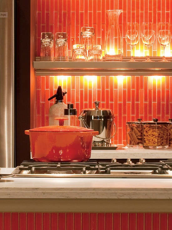 Bright orange in the kitchen! Bold subway tiles make a statement. Ever thought of doing vertical subway tiles for your backsplash? Classic but unique mosaic.