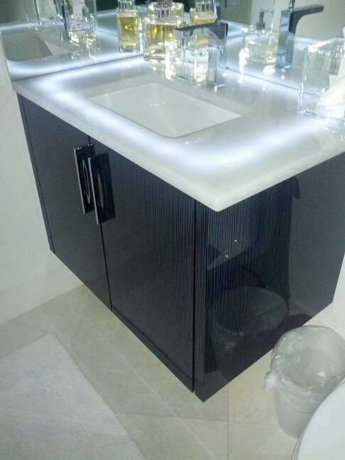 Photography Gallery Sites Naples condo lighted vanity Glass counter top LED lighting High gloss acrylic cabinetry