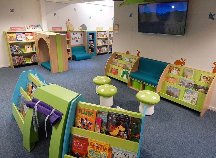 Toadstool seating in school themed library reading corner. Woodland and forest library. Book and reading tree. Primary school library.
