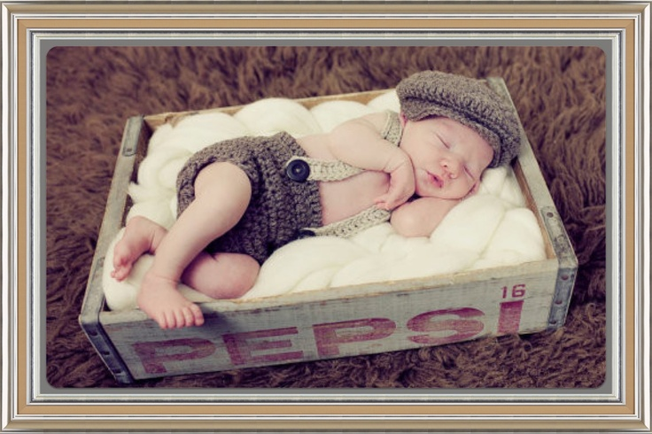 Is there a little man in your life with a little old time charm? This chocolate brown and beige newsboy set is sure to take anyone back to yesteryear with its classic hat and suspender shorts. Handmade with soft quality cotton yarn its ideal against newborns and babies skin. The pieces can be w...