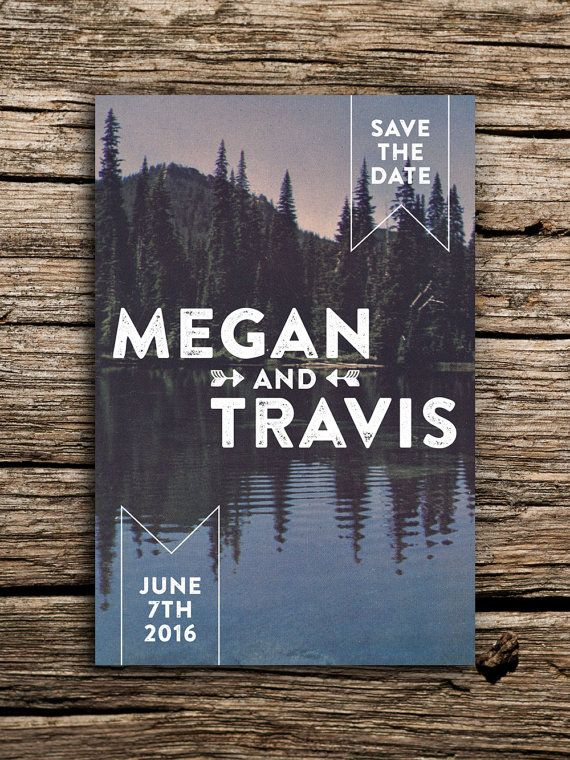 Save the date for your mountain wedding with this vintage postcard featuring bold white text set against a reflection of woodland pines on calm