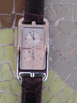 """Hermes Dual Time Zone Ladys Watch """"Cape Cod """" model CC3.210.230. Get the lowest price on Hermes Dual Time Zone Ladys Watch """"Cape Cod """" model CC3.210.230 and other fabulous designer clothing and accessories! Shop Tradesy now"""