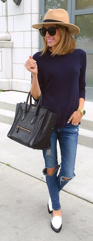 Classic women's street style, perfect outfit for spring. Ripped jeans, navy jumper and smart hat.