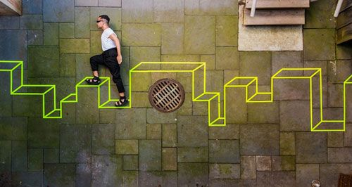 New York-based artist Aakash Nihalani is taking tape to the next level and beyond. He creates geometric, site-specific works of art using tape on walls, sidewalks, and every surface in between. The urban environment is his canvas and it appears that nothing is off limits from his three-dimensional looking works.