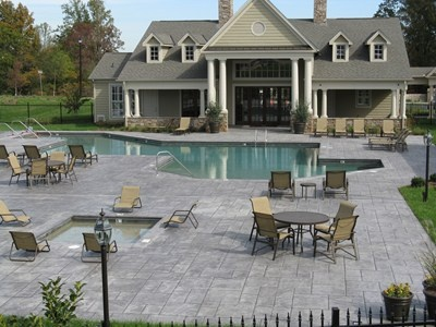 Large concrete pool deck complements this beautiful home.    Featured 11/21/12. Stampitcrete LLC Fortson, GA