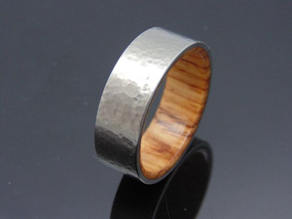 Titanium ring with waterproof Honduran Rosewood Unique hammered finish that can only be achieved by hand. No cookie cutter computer