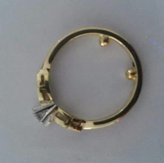 My solution to the age old problem of large knuckles and thin fingers. These 'balls' don't hinder getting the ring on but help to stop the swinging of a top heavy ring and are much more comfortable to wear than the traditional 'keepers' that jewelers still sell.