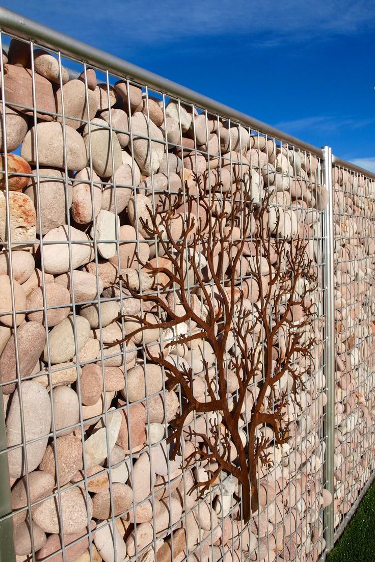 Pebble gabion wall