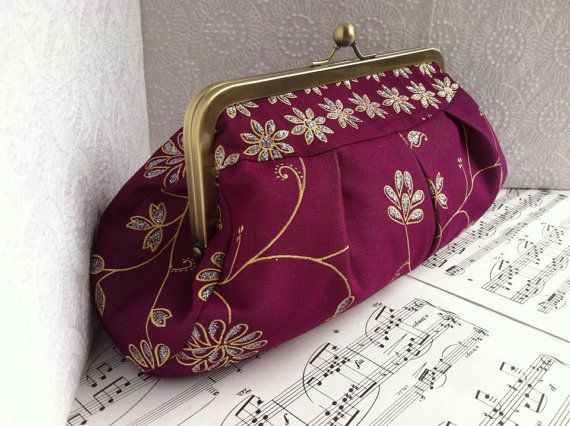 Hey, I found this really awesome Etsy listing at https://www.etsy.com/listing/187927999/violet-clutch-purse-gold-and-purple