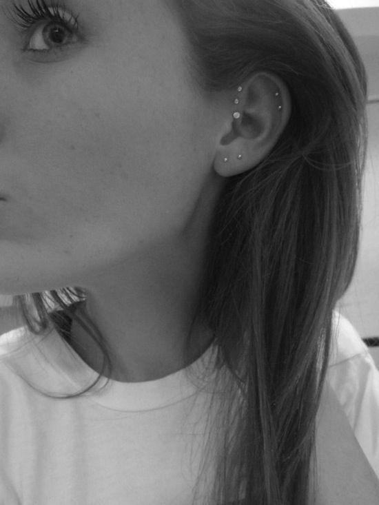 perforaciones en orejas aretes