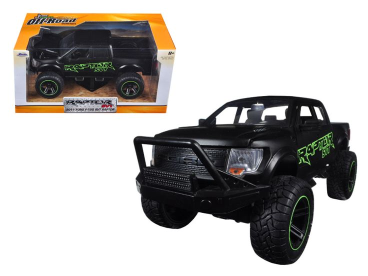 2011 Ford F-150 SVT Raptor Matt Black/Green Pickup Truck Off Road 1/24 Diecast Model by Jada - Brand new 1:24 scale diecast model car of 2011 Ford F-150 SVT Raptor Matt Black/Green Pickup Truck Off Road die cast car model by Jada. Rubber tires. Brand new box. Comes in a window box. Detailed interior, exterior. Has opening doors, hood and rear gate. Made of diecast with some plastic parts. Dimensions approximately L-8.5, W-4.25, H-4.75 inches. Please note that manufacturer may change packing…