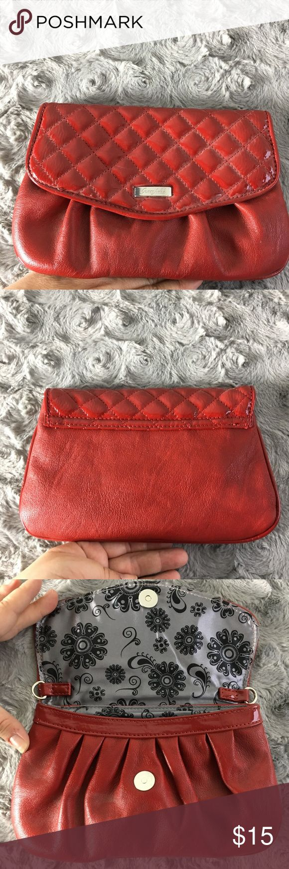 Grace Adele Quilted Red Clutch w/ Strap This clutch by Grace Adele is like new.  It has a quilted patent red foldover closure and pleated red faux leather bottom.  The interior has several pockets/slots for credit cards & such.  This purse can be carried as a clutch or small purse (strap included.)  Please see pics for approximate measurements. Grace Adele Bags Clutches & Wristlets