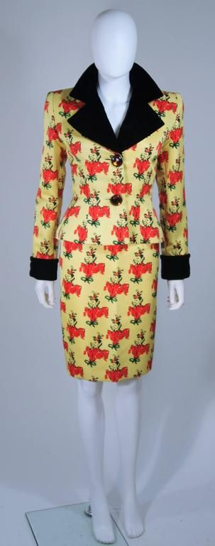 This Givenchy Couture skirt suit is composed of a yellow silk with a portrait pattern print and velvet trim. The jacket has a slight peplum style and large citrine hue rhinestone button closures, at the center front. The pencil style skirt has a