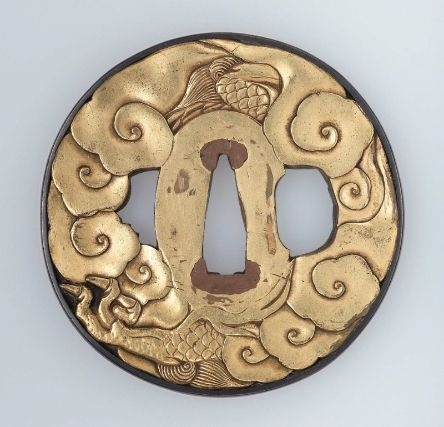 Tsuba with design of dragon and clouds Japanese, Edo Period, early to mid-19th century, MFA