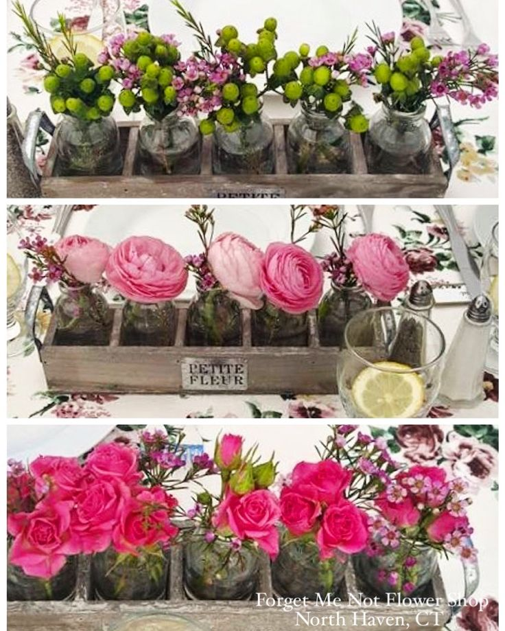 Various Different Flowers In Small Containers For Wedding