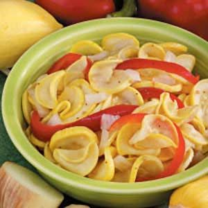 """So-Sweet Squash Pickles - Taste of Home - """"These crisp crunchy slices, seasoned with celery seed and mustard seed, have a sweet-sour taste that everyone is sure to relish! The colorful blend of yellow squash, sweet red pepper and chopped onion makes a beautiful presentation."""" -Eleanor Sundman Farmington, Connecticut"""