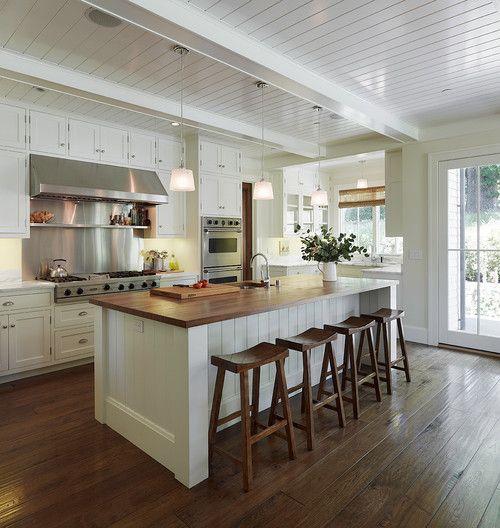 Saddle stools, stainless backsplash, beadboard ceiling | Taylor Lombardo Architects, San Francisco.