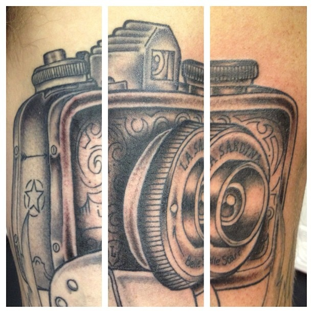 My tattoo so far, still need highlights.  It looks disjointed because it is three different photos, as it wraps around my arm.