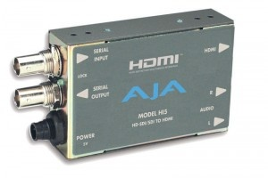 The Hi5 HD-SDI/SDI to HDMI Video and Audio Converter from AJA is a device designed to convert SDI or HD-SDI signals to HDMI for driving HDMI monitors. This unit also supports embedded SD/HD-SDI audio in the HDMI output, allowing for a convenient single-cable, audio-video connection. The Hi5 provides 2-channel, RCA-style, audio outputs for the separate monitoring of audio feeds. It also offers a looping SDI/HD-SDI output.