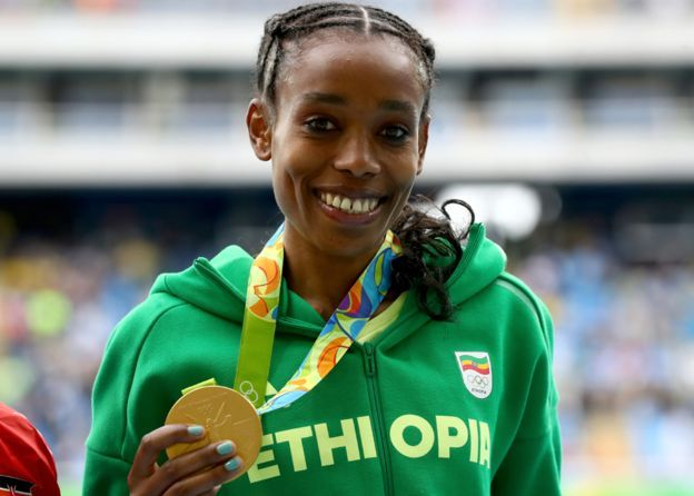 Almaz Ayana of Ethiopia poses with the gold medal for the Women's 10,000 Meters…