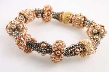 Using crystals and pearls, you'll create a variety of beautiful slider beads that are held in place with increased herringbone tubular bumps. Each versatile bead will fit on the bracelet with just the