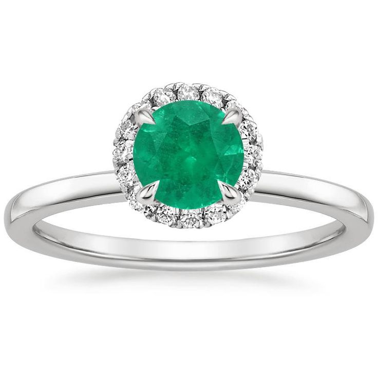 This Vienna Diamond Ring (1/4 ct. tw.) has a carat shaped Medium Intense Green Emerald with -clarity.