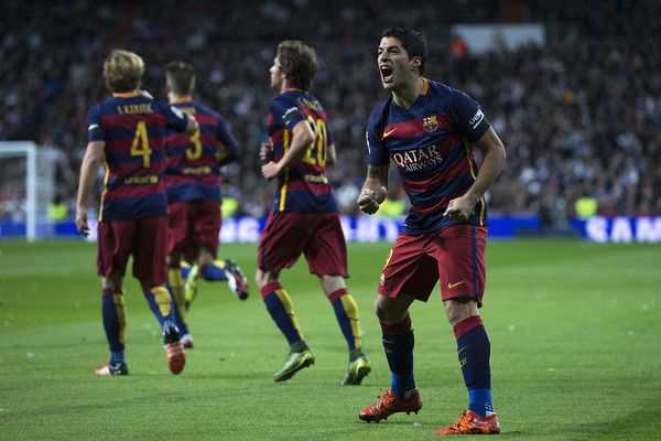 Luis Suarez of FC Barcelona celebrates scoring their opening goal during the La Liga match between Real Madrid CF and FC Barcelona at Estadio Santiago Bernabeu on November 21, 2015 in Madrid, Spain.