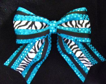 How to Make a Cheerleading Hair Bow. Perfect not only for cheerleaders but school spirit in general! Use puffy paint on the bow to write or draw or design to create a specialized bow!