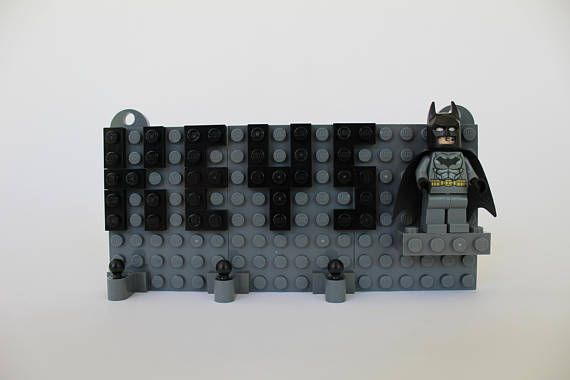 Buy this great LEGO Keychain Organizer with Batman Minifigure wall mounted household key organizer, and youll have THE SPECIAL ring organizer to rule them all! Our key ring organizer is a wall mounted LEGO brick built key holder in dark grey brick with the word KEYS displayed in black