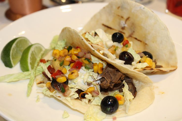 Bourbon Glazed Beef Tacos topped with Blueberry Roasted Corn Salsa and Cilantro Cream Sauce